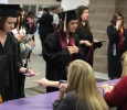 Melanie Sharp, nursing, and Stephanie Rodriguez, general business, check in and receive their name cards at Midwestern State University graduation, May 16, 2015 at the Kay Yeager Coliseum. Photo by Francisco Martinez