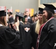 Michelle Sutton, English, takes a picture of Dusti Cribbs, English, and Taylor Baggett, English, at Midwestern State University graduation, May 16, 2015 at the Kay Yeager Coliseum. Photo by Francisco Martinez