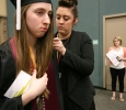 Kayla Brixey, registrar assistant, helps fix Emmily Ann Holub's, political science, gown before the ceremony at Midwestern State University graduation, May 16, 2015 at the Kay Yeager Coliseum. Photo by Rachel Johnson