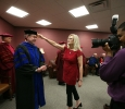 Cindy Ashlock, executive assistant to the President, moves Retiring University President Jesse Rogers' tassle out of his face int he greeen room before the ceremony at Midwestern State University graduation, May 16, 2015 at the Kay Yeager Coliseum. Photo by Rachel Johnson
