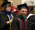 Robin Goodfellowe, science and mathematics senior, receives his masters hood at Midwestern State University graduation, May 16, 2015 at the Kay Yeager Coliseum. Photo by Francisco Martinez