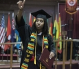Andrea Carter, accounting, waves to the audience after receiving her diploma at Midwestern State University graduation, May 16, 2015 at the Kay Yeager Coliseum. Photo by Rachel Johnson