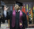 Edder Jaimes, business management, waves to the audience after walking the stage and receiving his diploma at Midwestern State University graduation, May 16, 2015 at the Kay Yeager Coliseum. Photo by Rachel Johnson