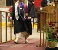 Traci Morrison, interdisciplinary studies senior, walks onto the stage at Midwestern State University graduation, May 16, 2015 at the Kay Yeager Coliseum. Photo by Francisco Martinez