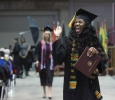 Farrellin Porter, nursing, sends a big wave tothe audience while walking back to her seat after receiving her diploma at Midwestern State University graduation, May 16, 2015 at the Kay Yeager Coliseum. Photo by Rachel Johnson