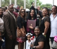 Chelsey Payne, interdisciplinary studies, family gathers to take a photo after the ceremony at Midwestern State University graduation, May 16, 2015 at the Kay Yeager Coliseum. Photo by Francisco Martinez