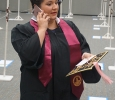 AnnMarie Bush, music, stops to take a phone call before lining up at the Midwestern State University graduation Dec. 17, 2016. Photo by Brendan Wynne