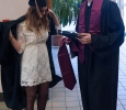 Business majors, Madeline Hoff and Ryan Booker put together their attire for commencement at the Midwestern State University graduation Dec. 17, 2016. Photo by Brendan Wynne