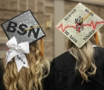 Blaire Untalen and Kari Goen, nursing graduates, show off their hats at the Midwestern State University graduation, Fall 2016. Photo by Jeanette Perry.