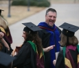 Jeff Killion, radiologic sciences chair, high-fives students after the ceremony at Midwestern State University fall graduation Dec. 17, 2016. Photo by Brendan Wynne