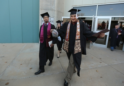 Jared Tuilagi, sporting a sash made by his mom, received a Bachelor of Arts in education at graduation, Dec. 16, 2017. Photo by Bradley Wilson