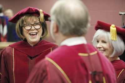 Nancy Marks, board of regents member, and Shelley Sweatt, board of regents member, prepare for MSU's commencement ceremony at Kay Yeager Coliseum. Saturday Dec. 16, 2017. Photo by Francisco Martinez