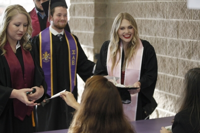 Taylor Amundson, exercise physiology, receives her name card before the MSU commencement ceremony at Kay Yeager Coliseum. Saturday Dec. 16, 2017. Photo by Francisco Martinez