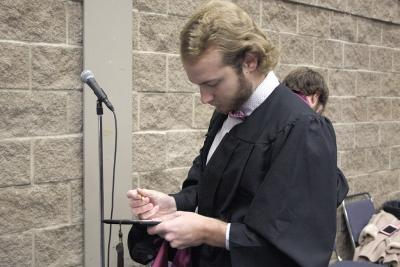 Tyler Colley, BFA graduate, fills out his information card at the fall 2017 commencement at the Kay Yeager Colliseum on Sat. Dec. 16, 2017. Photo by Justin Marquart