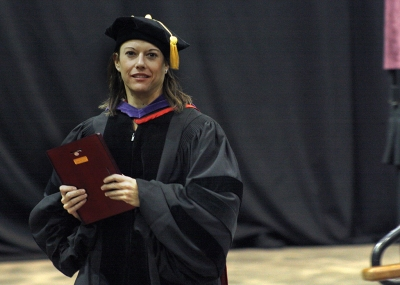 Laura Fidelie, assosiate profesor for criminal justice, recieves the faculty award at the fall 2017 commencement at the Kay Yeager Colliseum on Sat. Dec. 16, 2017. Photo by Justin Marquart