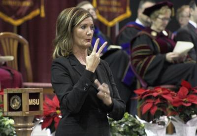Lori Shrah, asl interpretor, signs at the fall 2017 commencement at the Kay Yeager Colliseum on Sat. Dec. 16, 2017. Photo by Justin Marquart