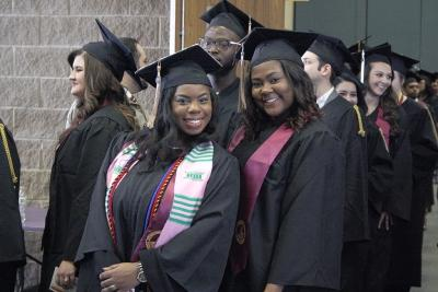 Shayla Owens, BBA graduate, and Alexus Page, BBA graduate, pose while waiting for the the line to move to go to the colliseum at the fall 2017 commencement at the Kay Yeager Colliseum on Sat. Dec. 16, 2017. Photo by Justin Marquart