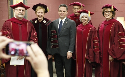 MSU's faculty members gather for a group picture before the MSU commencement ceremony at Kay Yeager Coliseum. Saturday Dec. 16, 2017. Photo by Francisco Martinez