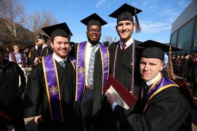Tyler Browning, Valentine Atuchukwu, Seth Phillips and Mike Privitt at graduation, Dec. 16, 2017. Photo by Bradley Wilson