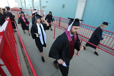Graduating seniors walk in to the Kay Yeager Coliseum at graduation, Dec. 16, 2017. Photo by Bradley Wilson