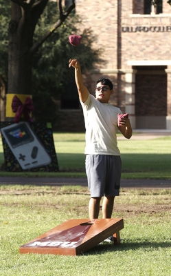 AJ Rubio, mechanical engineering sophomore, tosses a sand bag during a game of cornhole at the quad for field day competitions on Wednesday, Oct 18, 2017. Photo by Sara Keeling