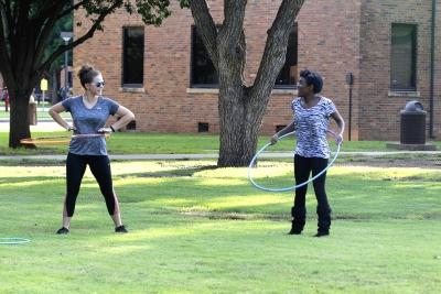 Mikayla Thompson, nursing freshman, and Candace Bledsoe, nursing freshman, hoolahoop on the quad in a attempt to take a break from studying on Oct 18, 2017 for the field day competitions. Photo by Sara Keeling