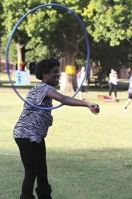 Candace Bledsoe, nursing freshman, hoolahoops on the quad at the homecoming field day competitions in an attempt to take a break from studying on Oct 18, 2017. Photo by Sara Keeling