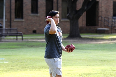 Johnny Dang, pre med sophomore, throws in a sand bag in a game of cornhole at the homecoming field day competitions on Oct 18, 2017. Photo by Sara Keeling