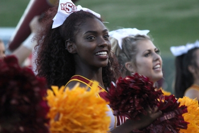Cheerleading Captain Markiela Benoit, dental hygiene senior, cheers for MSU on the sidelines at Memorial Stadium during the Homecoming Game against West Texas A&M on Saturday, Oct. 21, 2017. Photo by Rachel Johnson