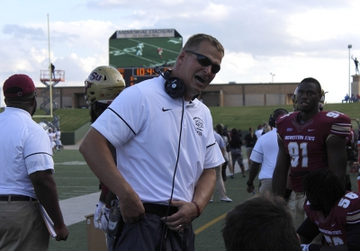 Definsive line Randy Wilkins speaks to his team with a sincere voice on the sidelines during the homecoming game on Saturday, Oct. 21, 2017. Photo by Sara Keeling.