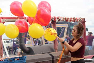 Madison Scoggins, composite science senior, helps hang up balloons for the Chi-Omega and Sigma Alpha Epsilon Tailgate for the Homecoming Tailgate, Saturday, Oct. 21, 2017. Photo by Rachel Johnson