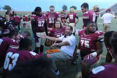 An assistant coach talks with players at the homecoming game against West Texas A&M Oct. 21, 2017. MSU won the game, called with about 5 minutes left on the clock due to weather, 45-3. Photo by Bradley Wilson.