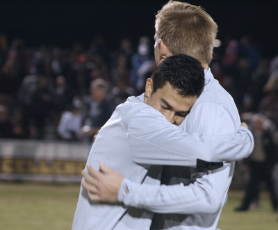 Midfielder and business management sophomore embraces defender and business sophomore RJ Slayer, after MSU wins 2-0 against Colorado School of Mines in the NCAA Division II South Central Regional Championships. Nov 16. Photo by Bridget Reilly