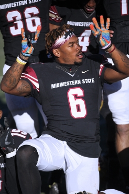 Wide receiver and applied arts and science senior Brandon Sampson, holds up a 2 and a 4 on his fingers in honor of Robert Grays, where MSU won 24-20 against University of Sioux Falls in the first NCAA Division II playoff game. Nov 18. Photo by Bridget Reilly