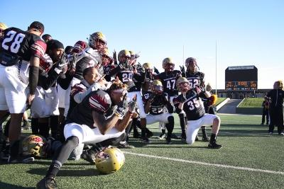 The MSU Football poses for pictures after the end of the NCAA II Round One Playoffs Game where MSU beat University of Sioux Falls 24-20, pushing MSU to Round Two of playoffs against Minnesota State. Photo by Rachel Johnson