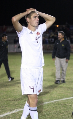 Patrick Fitzgerald, kinesiology junior, puts his hand on his head after a close game with two overtimes and 6 rounds of penality kicks against Cal Poly Pomona, where they won 6-5 in the PK shoot out. Photo by Rachel Johnson
