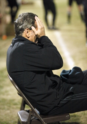 Head coach Doug Elder takes a moment to gather himself after Cal Poly Pomona matches the score to 2-2 in the second half of the NCAA Divison II Championship playoff. Nov 18. Photo by Bridget Reilly