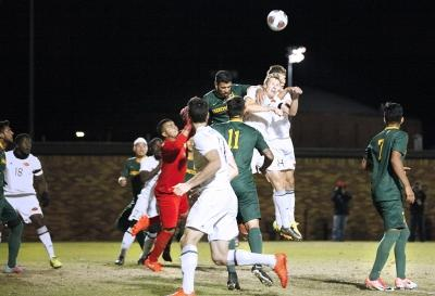 Midfielder and business senior Pierre Bocquet jumps to deflect a corner kick by Cal Poly Pomona with midfielder and exercise physiology sophomore Ross Fitzpatrick in the NCAA Division II Championship playoff. Nov 18. Photo by Bridget Reilly