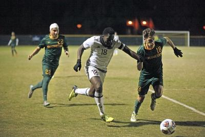 Defender and finance junior Koby Sapon-Amoah attempts a shot at goals against Cal Poly Pomona in the NCAA Division II Championship playoff. Nov 18. Photo by Bridget Reilly