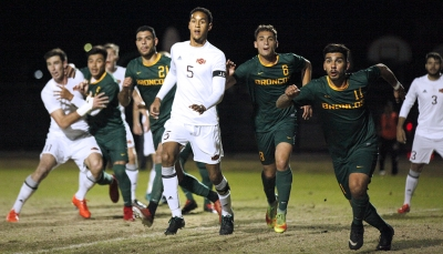 Defender and business senior Jordan Speed chases a corner kick by Cal Poly Pomona, in the NCAA Division II Championship playoff. Nov 18. Photo by Bridget Reilly