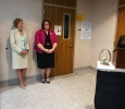 Andrea Mendoza-Lespron thanks former Provost Betty Stewart at a reception in Stewart's honor. Photo by Bradley Wilson.