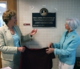 University President Suzanne Shipley and Board of Regents member Nancy Marks unveil the palque in honor of former provost Betty Stewart in Bolin hall. Photo by Bradley Wilson