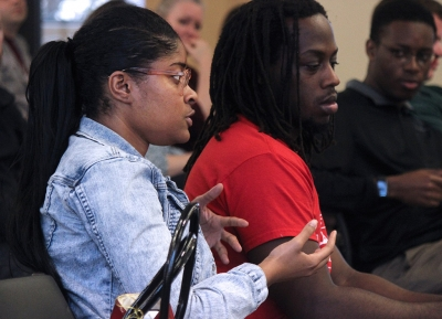 """Latoya Fondren, mass communication junior, asks the only question in the talk-back portion of the Critical Conversations: """"Degrees of Freedom: Is Free Speech Free?"""" held in the Legacy Multi-Purpose Room, Monday, Feb. 19, 2018. Photo by Rachel Johnson"""