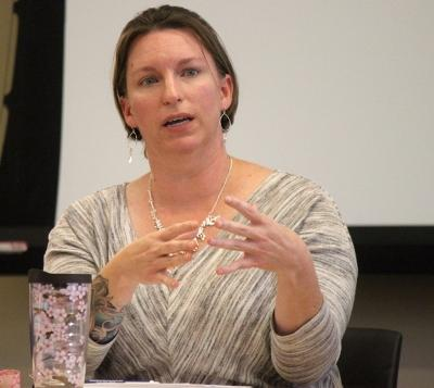 """Andrea Button, sociology assistant professor, is apart of the panel discussion in Critical Conversations where they talked about first ammendment rights, specifically freedom of speech, in the Legacy Multi-Purpose Room, Monday, Feb. 19, 2018. """"Things look the way they are...because our culture has maintained, proclaimed, and enabled it,"""" Button said. Photo by Rachel Johnson"""