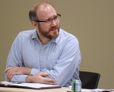 """Donovan Irven, philosophy visiting assistant professor, speaks on how great of an opportunity students of Midwestern have being at a liberal arts college and gaining a broad education at Critical Conversations: """"Degrees of Freedom: Is Free Speech Free?"""" held in Legacy Multi-Purpose Room, Monday,Feb. 19, 2018. """"The idea that education is this instrumental thing [just] to get a job and make money is this profound and deep protrayal to what you [the students] are doing here and what you have the opportunity to do here,"""" Irven said. Photo by Rachel Johnson"""