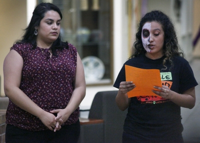 Brenda Adame, bilingual education sophomore, and Patricia Ramirez, bilingual education senior, welcome MSU students and guest during the Dia de los Muertos event held by multiple organizations in the Atrium, Wednesday, Nov. 1, 2017. Photo by Francisco Martinez