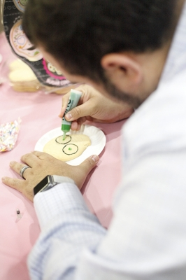 Mario Ramirez, student involvement interim director, decorates a skull shaped cookie during the Dia de los Muertos event held by multiple organizations in the Atrium, Wednesday, Nov. 1, 2017. Photo by Francisco Martinez