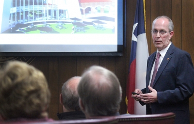 Kyle Owen, facilities services associate vice president, presents to the board with budget cuts to the original plans for the new Health Science Building, held in the Board Room in Hardin, Wed., Dec. 13, 2017. Photo by Rachel Johnson