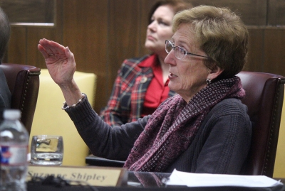 University President Suzanne Shipley explains to Shawn Hessing, board of regents member, the answer to his question of why they had to pay a fee for the architecture to make changes to blueprints for the Health Sciences building to stay in budget. Photo by Rachel Johnson