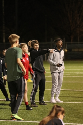 Steve Pondeca, finanace redshirt sophomore, and Alex Dimitriu, undecided sophomore, provide key movements to foocus on during practice at the recreational athletic fields. Wednesday, Jan. 24, 2018. Photo by Francisco Martinez